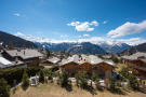 View over chalet rooftops and mountains - Mettaney Penthouse