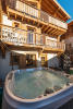 Chalet exterior with Jacuzzi on terrace