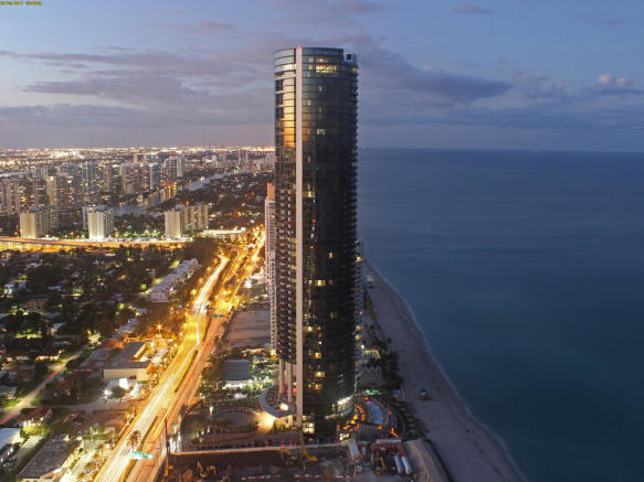 Porsche Design Tower in Miami - aerial side elevation view at dusk