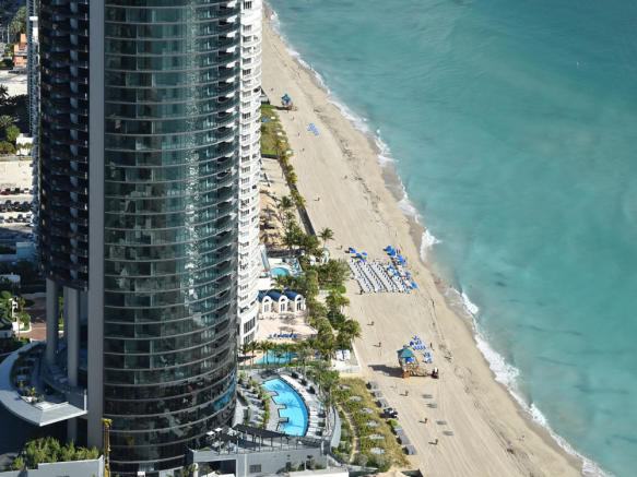 Porsche Design Tower in Miami - aerial view of pool and beach area 1