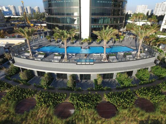 Porsche Design Tower in Miami - raised pool area by beach