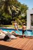 Family poolside fun at Arokaria Luxury Villas Mauritius