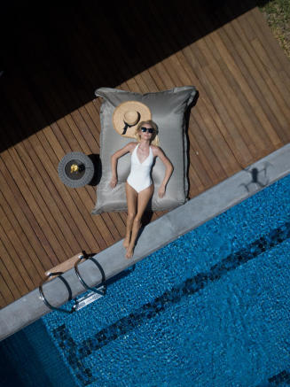 Lady relaxing by pool at Arokaria Luxury Villas Mauritius