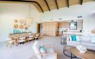 Panigia Beach Penthouse B kitchen and dining area