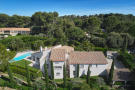 Aerial view of side elevation of 5-bed villa with pool and landscaped garden in Mougins, France