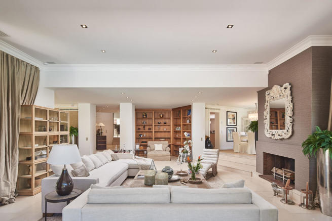 Elegant and spacious living room in 5-bed villa in Mougins with open fireplace and open-plan access to the dining room