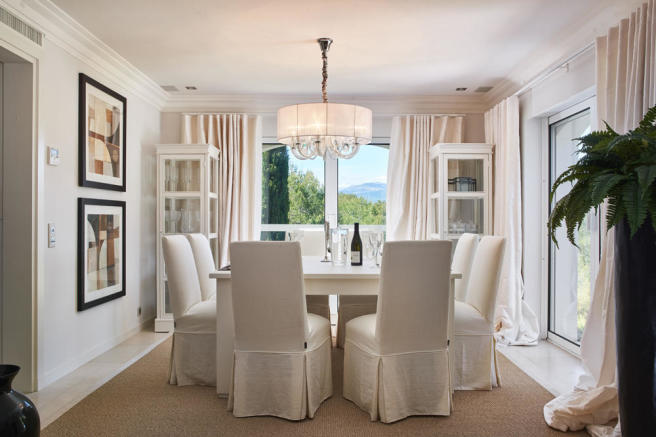Elegant dining room off large living room with direct access to the kitchen