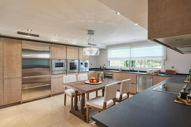Spacious fully fitted kitchen in 5-bed luxury villa in Mougins