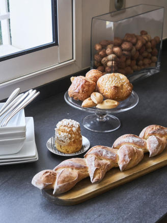 Detail shot of fresh bread and pastries in spacious kitchen of a 5-bed villa in Mougins