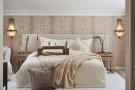 Close up of master bedroom double bed with patterned wallpaper in a 5-bed villa in Mougins