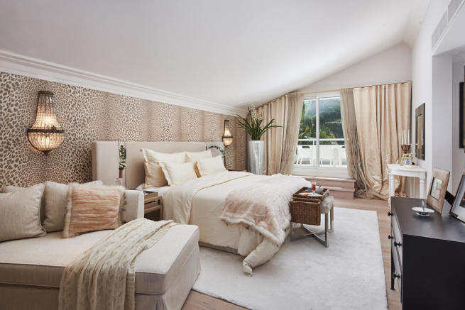 Large master bedroom with patterned wallpaper and access to private roof terraces in a 5-bed luxury villa in Mougins, France