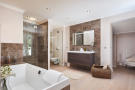 Master en suite bathroom with bath and shower in a 5-bed luxury villa in Mougins, France