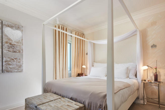 Guest bedroom of a 5-bed villa in Mougins featuring a four-poster bed