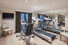 Private fitness room with gym equipment in a 5-bed luxury villa in Mougins, France