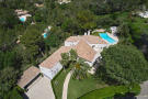 Aerial view of 5-bed villa with landscaped garden, pool and covered parking area in Mougins, France