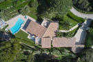 Aerial view looking straight down onto a 5-bed luxury villa with pool and landscaped garden in Mougins, France