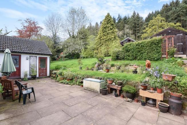 Rear terrace with adjoining pond