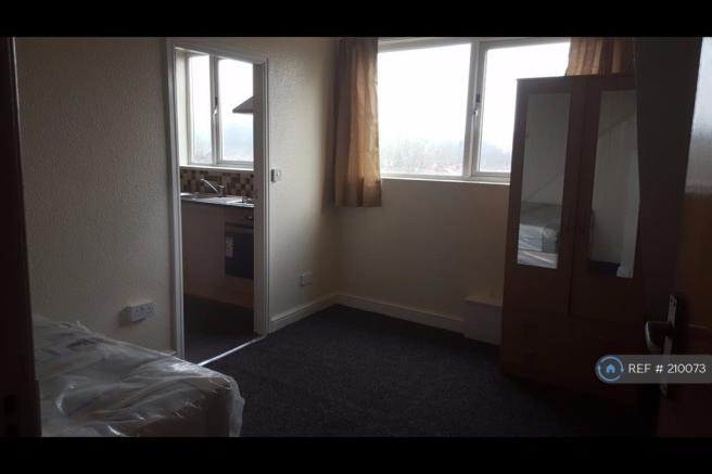 Bedroom Furnished With Wardrobe And Bed