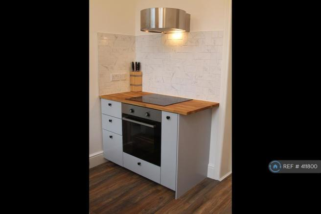 New Kitchen With Electric Cooker And Fan