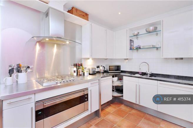 Kitchen With Garden Views And Separate Utility