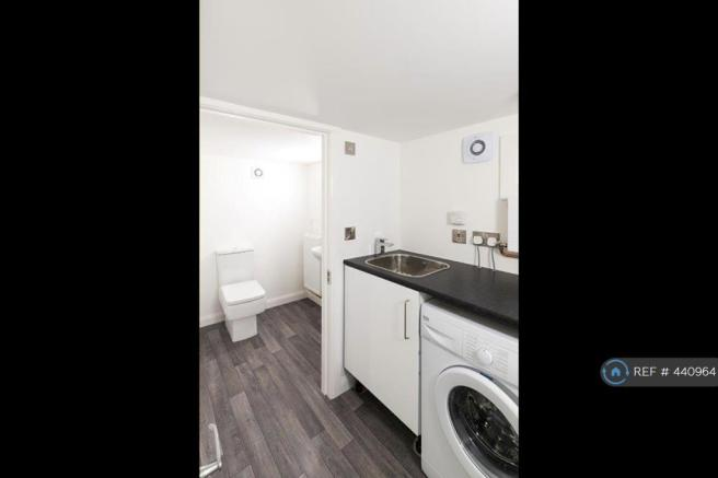 Laundry Room And Small Toilet