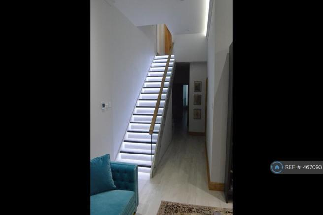 Stairs Down To Basement With 3m High Ceilings.