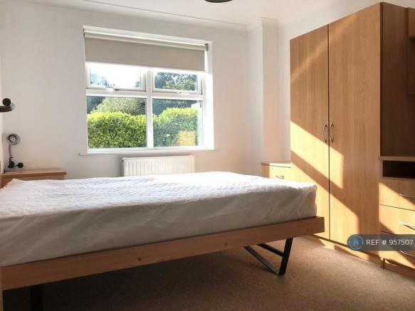 Sunny Bedroom With Built In Wardrobe Storage