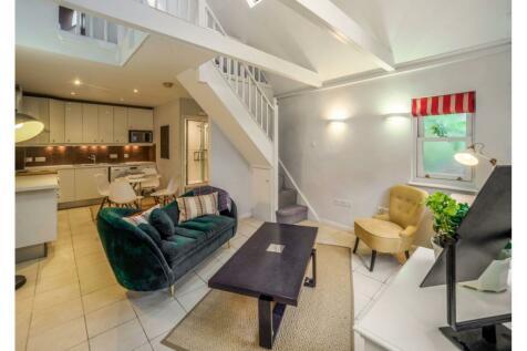 9 Addison Bridge Place, London, W14. Cottage