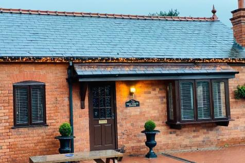 THE COACH HOUSE PLASSEY CRAFT CENTRE. 1 bedroom coach house